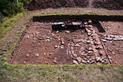 An excavation trench across Caerleon's quayside wall, wharves and jetties