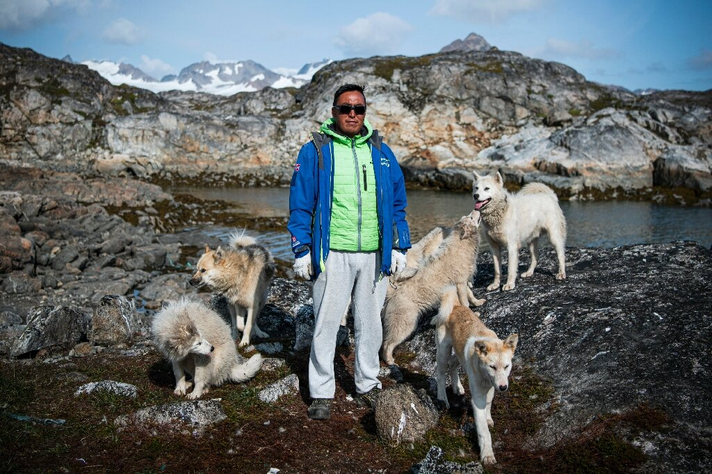 In Greenland village, shorter winters cast doubts over dog sledding