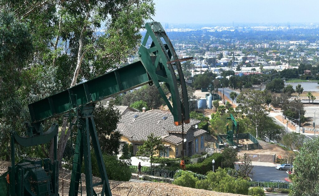 Los Angeles: Hollywood, palm trees and urban oil fields