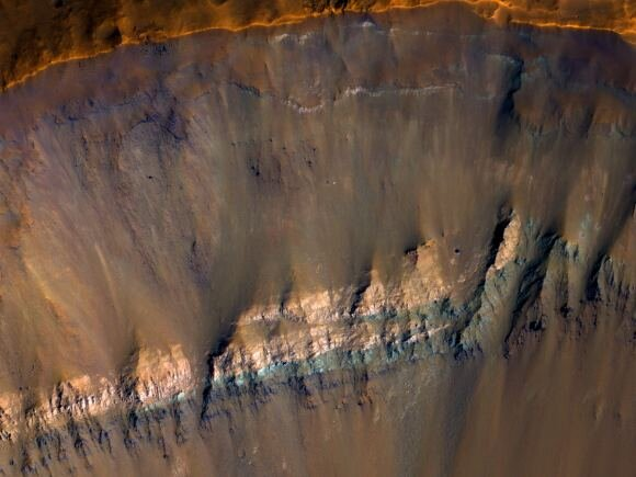 The colorful walls of an exposed impact crater on Mars