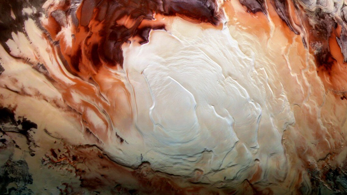 Mars' bright south pole reflections may be clay—not water