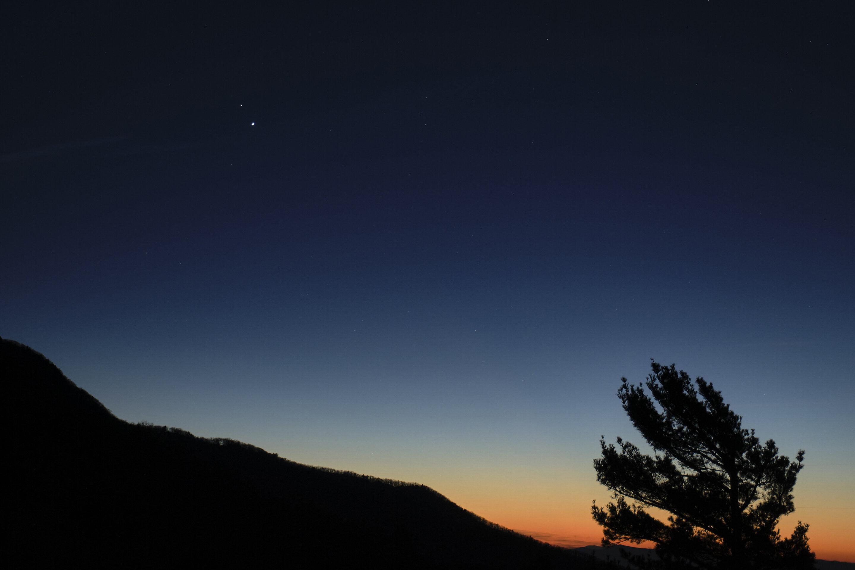 Jupiter, Saturn merging in night sky, closest in centuries